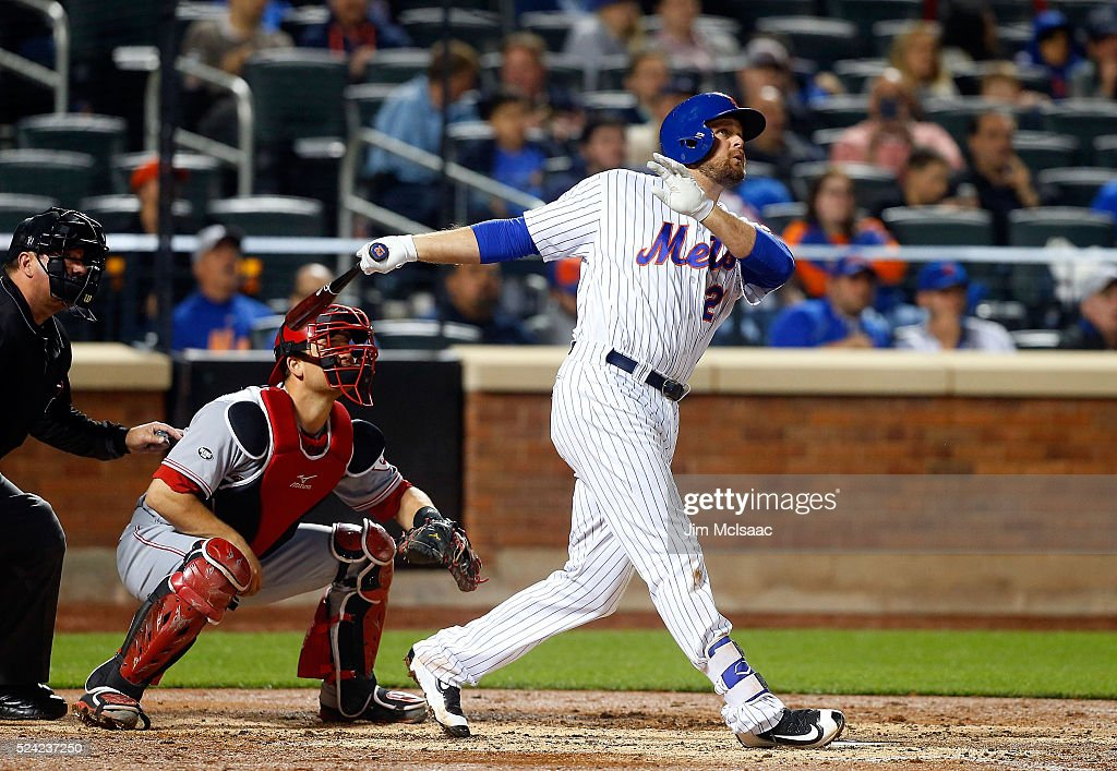 Lucas Duda #21 of the New York Mets follows through on his third inning two run home run against the Cincinnati Reds at Citi Field on April 25, 2016 in the Flushing neighborhood of the Queens borough of New York City.
