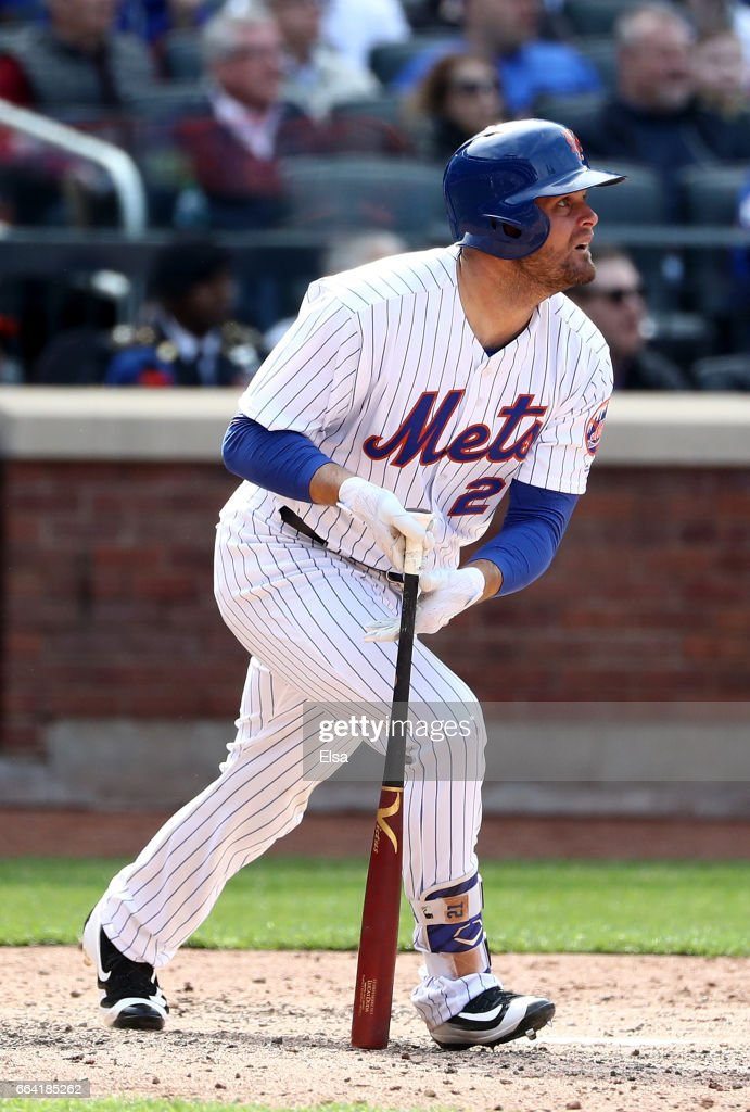Lucas Duda #21 of the New York Mets hits a three run double in the seventh inning against the Atlanta Braves during Opening Day on April 3, 2017 at Citi Field in the Flushing neighborhood of the Queens borough of New York City.