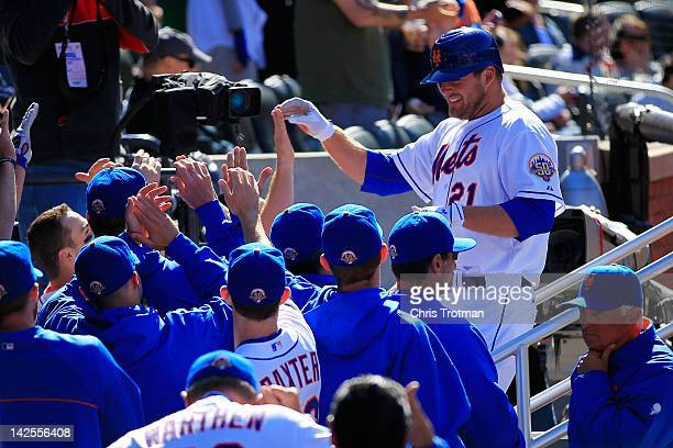 Lucas Duda of the New York Mets is congratulated by his teammates for his homer in the 7th inning against the Atlanta Braves at Citi Field on April...