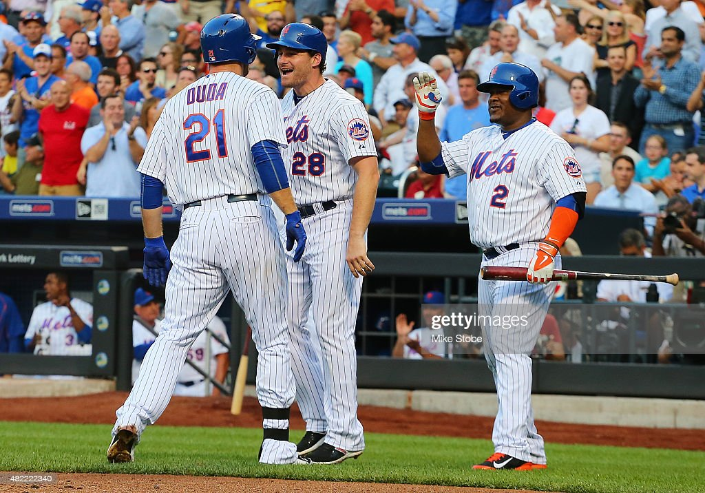 Lucas Duda #21 of the New York Mets is greeted by Daniel Murphy #28 and Juan Uribe #2 after hitting a two-run home run in the first inning against the San Diego Padres at Citi Field on July 28, 2015 in Flushing neighborhood of the Queens borough of New York City.