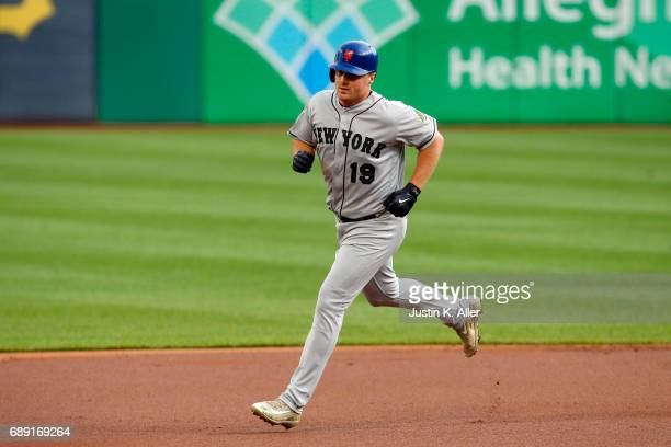 Lucas Duda of the New York Mets rounds second after hitting a solo home run in the first inning against the Pittsburgh Pirates at PNC Park on May 27,...