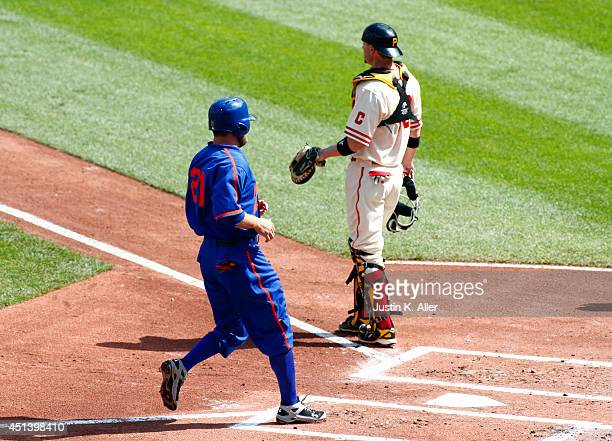 Lucas Duda of the New York Mets scores on a wild pitch in the first inning against the Pittsburgh Pirates during the game at PNC Park on June 28 2014...