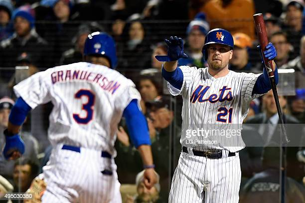 Lucas Duda of the New York Mets signals to teammate Curtis Granderson to stand up as he scores a run during Game 3 of the 2015 World Series against...