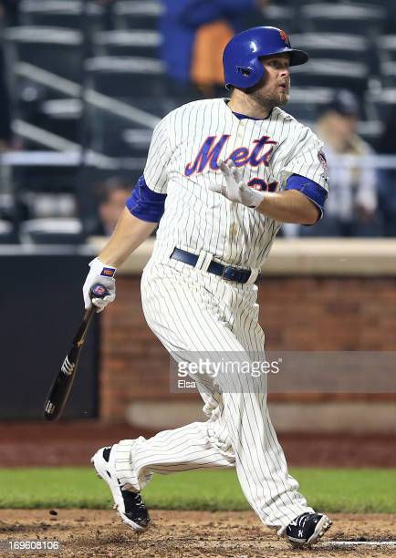Lucas Duda of the New York Mets watches his game winning RBI in the ninth inning against the New York Yankees on May 28, 2013 at Citi Field in the...
