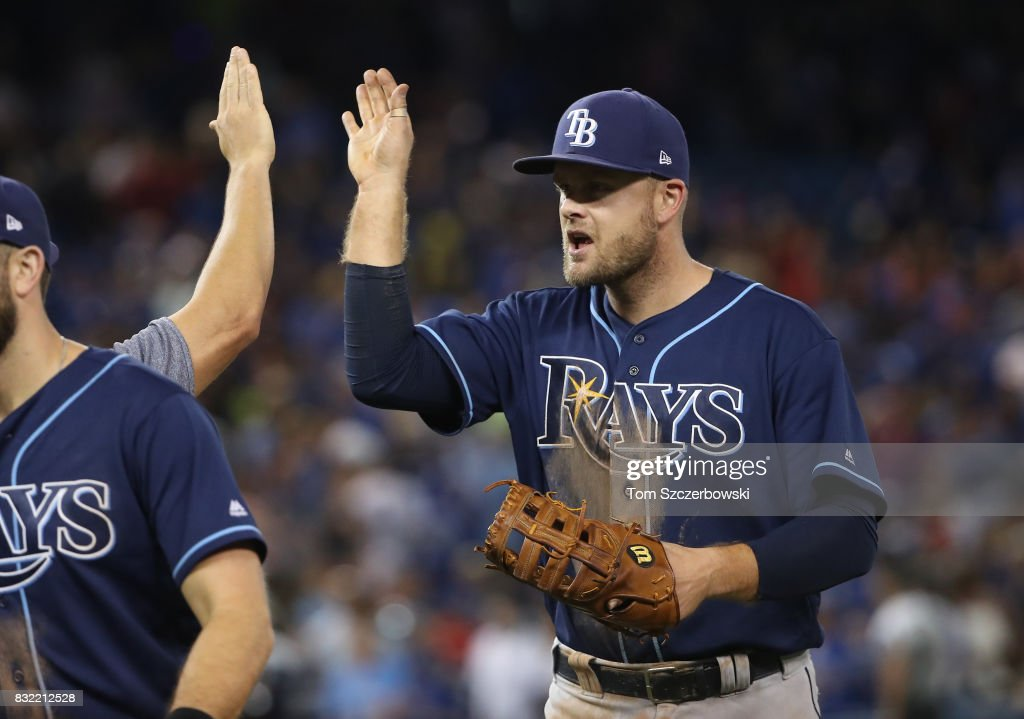 Lucas Duda #21 of the Tampa Bay Rays celebrates a victory with teammates after MLB game action against the Toronto Blue Jays at Rogers Centre on August 15, 2017 in Toronto, Canada.