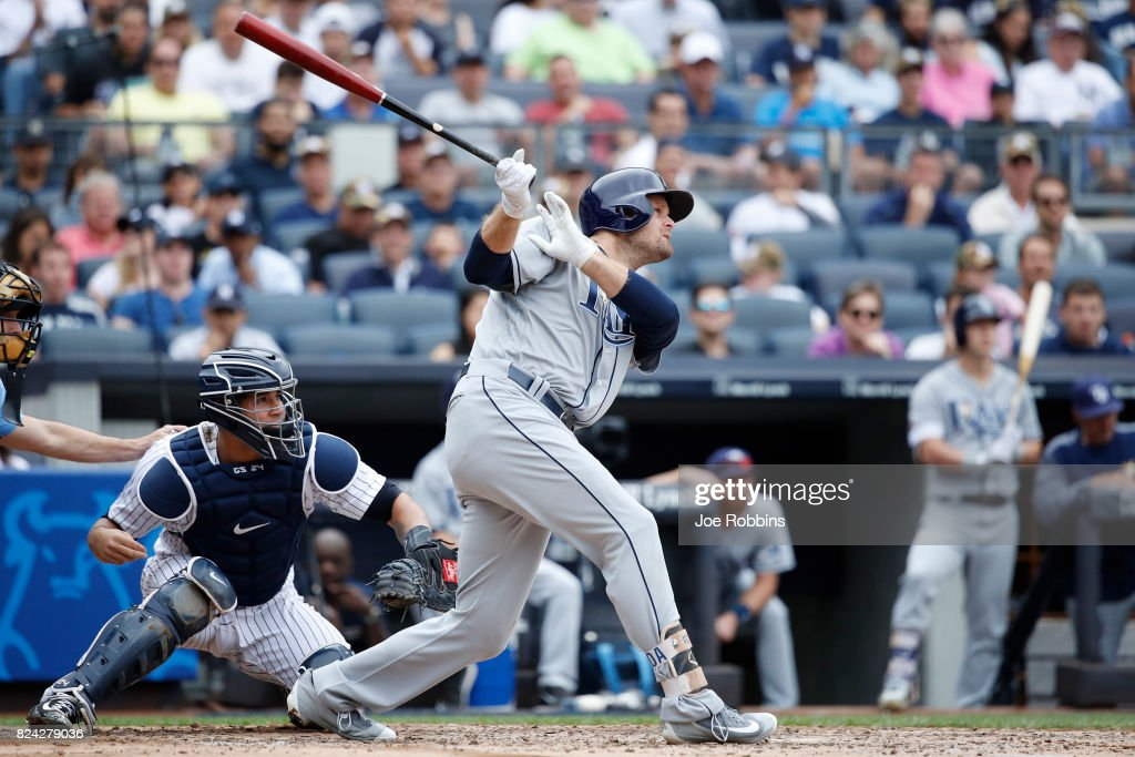 Lucas Duda #21 of the Tampa Bay Rays hits a sacrifice fly to drive in a run in the third inning of a game against the New York Yankees at Yankee Stadium on July 29, 2017 in the Bronx borough of New York City.