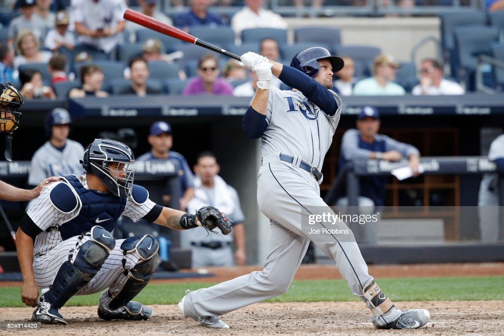 Lucas Duda #21 of the Tampa Bay Rays hits a solo home run to right field in the eighth inning to tie the game against the New York Yankees at Yankee Stadium on July 29, 2017 in the Bronx borough of New York City. The Yankees defeated the Rays 5-4.