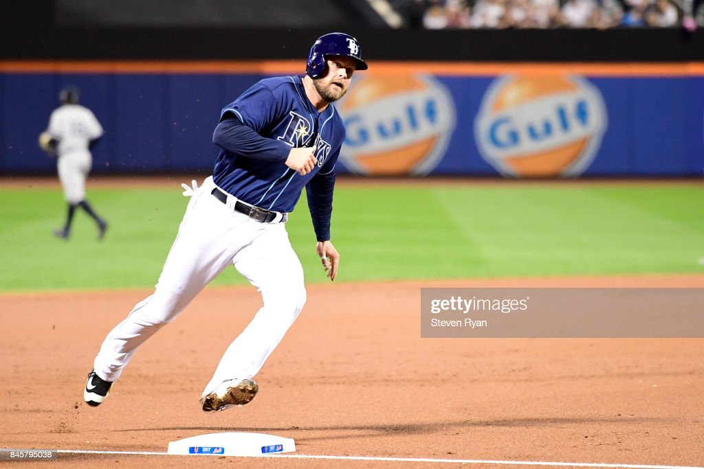 Lucas Duda #21 of the Tampa Bay Rays rounds third base to score a second inning run against the New York Yankees at Citi Field on September 11, 2017 in the Flushing neighborhood of the Queens borough of New York City. The two teams were scheduled to play in St. Petersburg, but due to the weather emergency caused by Hurricane Irma, the game was moved to New York, but with Tampa Bay remaining the 'home' team.