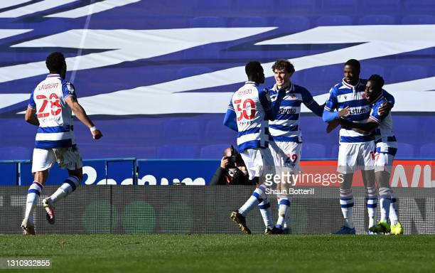 Lucas Eduardo Santos Joao of Reading celebrates with team mate Thomas Holmes, Alfa Semedo Esteves and Andy Yiadom after scoring their side's third...