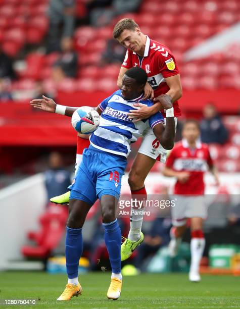 Lucas Eduardo Santos Joao of Reading is challenged by Dael Fry of Middlesborough during the Sky Bet Championship match between Middlesbrough and...