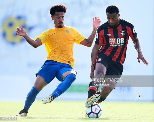 Lucas Evangelista of Estoril Praia competes for the ball with Lys Mousset of AFC Bournemouth during a Pre Season Friendly match between AFC...