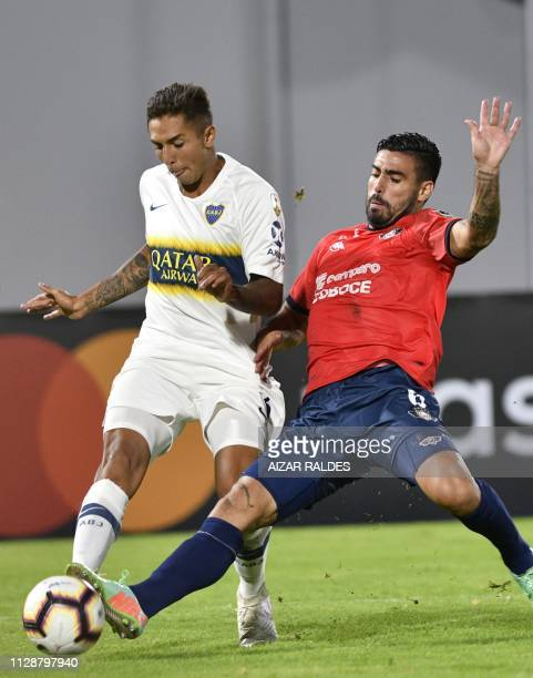 Lucas Gaucho of Bolivia's Wilstermann vies for the ball with Agustin Almendra of Argentina's Boca Juniors during their Copa Libertadores football...