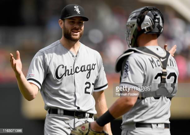 Lucas Giolito and James McCann of the Chicago White Sox celebrate after Giolito pitched a complete game against the Minnesota Twins on August 21,...