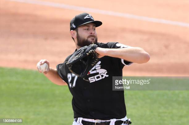Lucas Giolito of the Chicago White Sox delivers a first inning pitch against the Colorado Rockies during a spring training game at Camelback Ranch on...