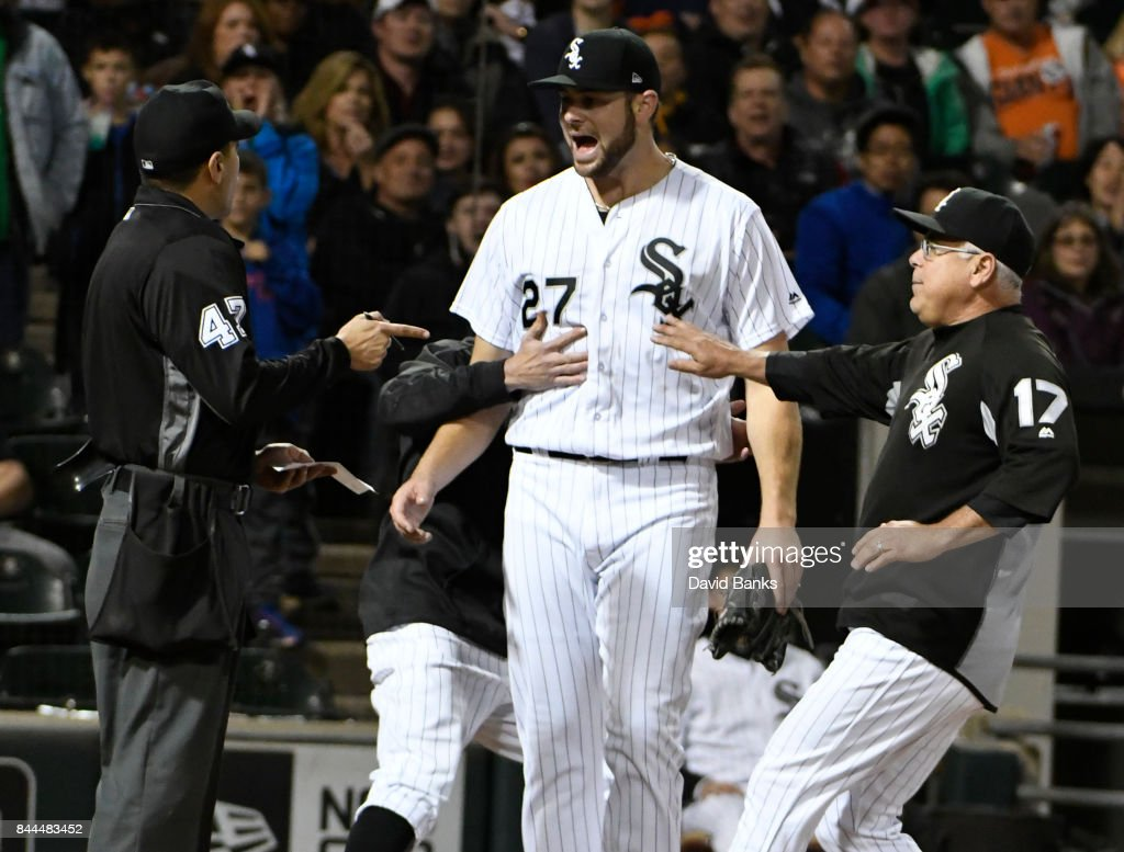 Lucas Giolito #27 of the Chicago White Sox is restrained by Rick Renteria #17 of the Chicago White Sox as he argues with home plate umpire Gabe Morales #47 during the sixth inning on September 8, 2017 at Guaranteed Rate Field in Chicago, Illinois.