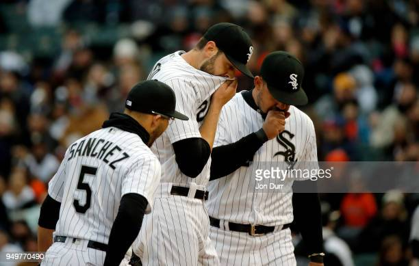 Lucas Giolito of the Chicago White Sox Yolmer Sanchez and Jose Abreu talk on the pitcher's mound during a break in the first inning against the...