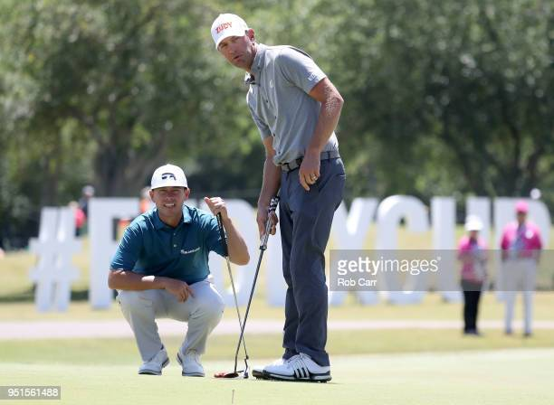 Lucas Glover and Chez Reavie line up a putt on the ninth hole during the first round of the Zurich Classic at TPC Louisiana on April 26 2018 in...