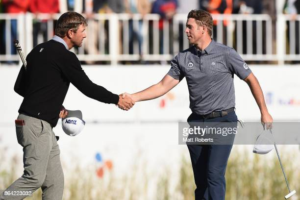 Lucas Glover and Luke List of the United States shake hands on the 18th green during the third round of the CJ Cup at Nine Bridges on October 21 2017...