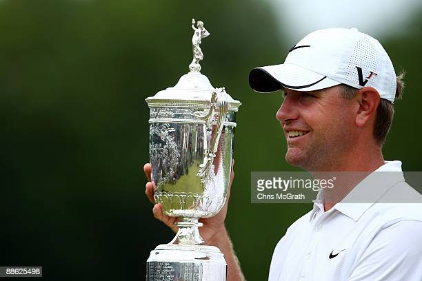 Lucas Glover celebrates with the winner's trophy after his twostroke victory at the 109th US Open on the Black Course at Bethpage State Park on June...