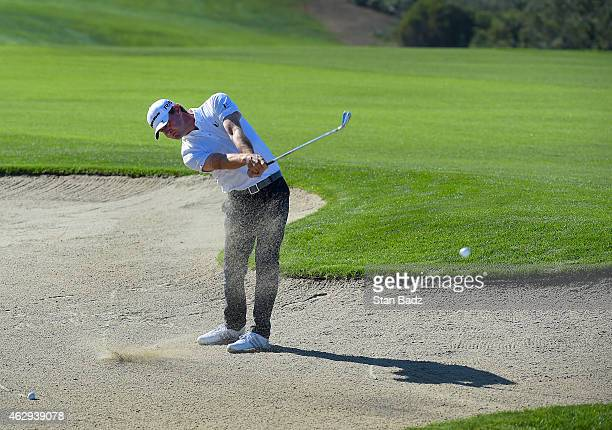 Lucas Glover hits from a bunker on the fourth hole during the third round of the Farmers Insurance Open at Torrey Pines Golf Course on February 7...