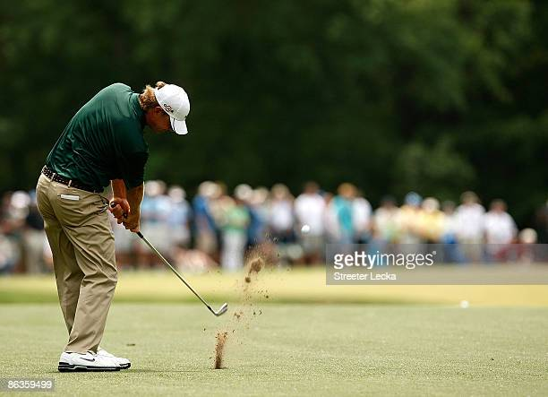 Lucas Glover hits his approach shot on the first hole during the final round of the Quail Hollow Championship at the Quail Hollow Club May 3 2009 in...