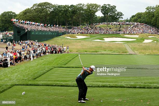 Lucas Glover hits his tee shot on the 17th hole during the continuation of the third round of the 109th US Open on the Black Course at Bethpage State...