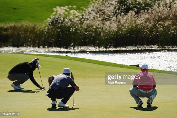 Lucas Glover Luke List and Scott Brown of the United States inspect the 5th green during the third round of the CJ Cup at Nine Bridges on October 21...