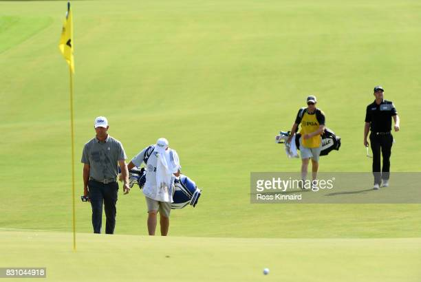 Lucas Glover of the United States and Jason Kokrak of the United States walk to the first green during the final round of the 2017 PGA Championship...