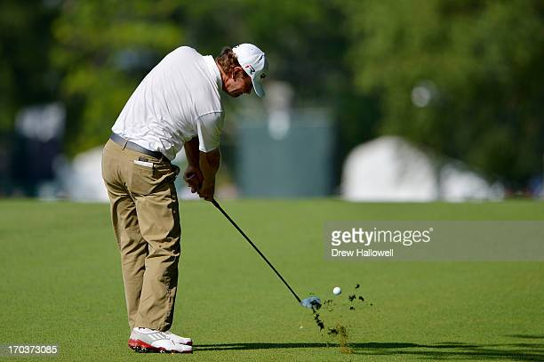 Lucas Glover of the United States hits an approach shot on the second hole during a practice round prior to the start of the 113th U.S. Open at...