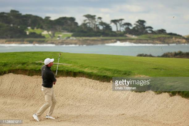 Lucas Glover of the United States plays a shot from a bunker on the 13th hole during the second round of the ATT Pebble Beach ProAm at Monterey...