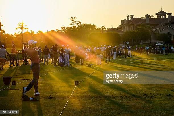 Lucas Glover warms up on the practice range as the sun rises during the first round of THE PLAYERS Championship on THE PLAYERS Stadium Course at TPC...