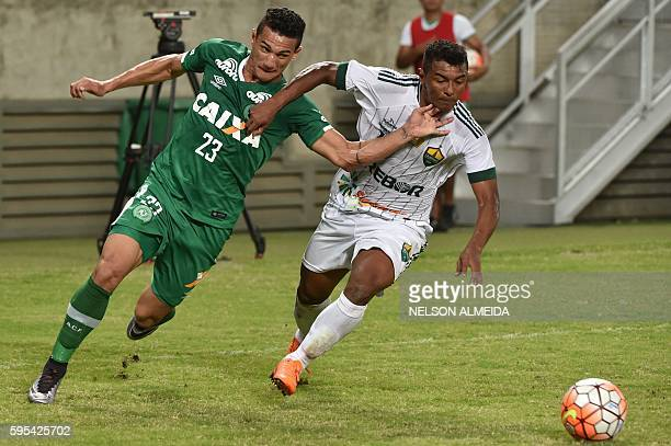 Lucas Gomes of Brazil's Chapecoense, vies for the ball with Maninho of Brazil's Cuiaba during their Sudamericana Cup football match held at the Arena...