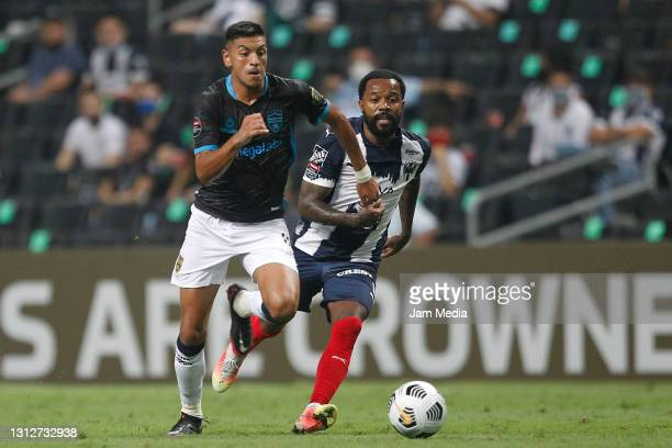 Lucas Gonzalez of Atletico Pantoja fights for the ball with Dorlan Pabon of Monterrey during a second leg match between Monterrey and Atletico...