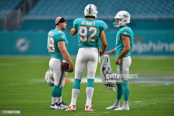 Lucas Gravelle John Denney and Matt Haack of the Miami Dolphins warm up before a preseason game against the Tampa Bay Buccaneers at Hard Rock Stadium...