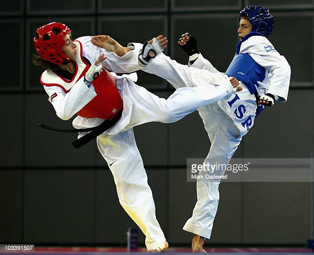 Lucas Guzman of Argentina competes against Gili Haimovitz of Israel in the Semifinal of the Mens 48kg Taekwondo on day one of the Youth Olympics at...
