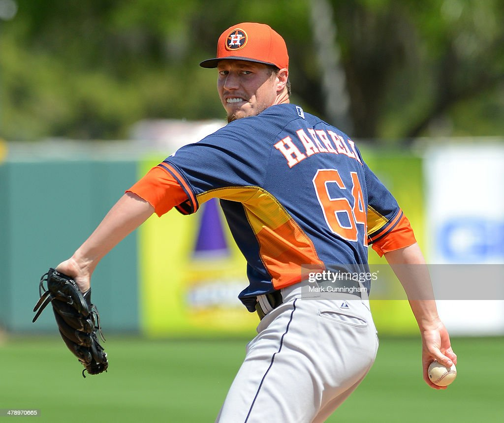 Lucas Harrell #64 of the Houston Astros pitches during the spring training game against the Detroit Tigers at Joker Marchant Stadium on March 15, 2014 in Lakeland, Florida. The Tigers defeated the Astros 14-3.