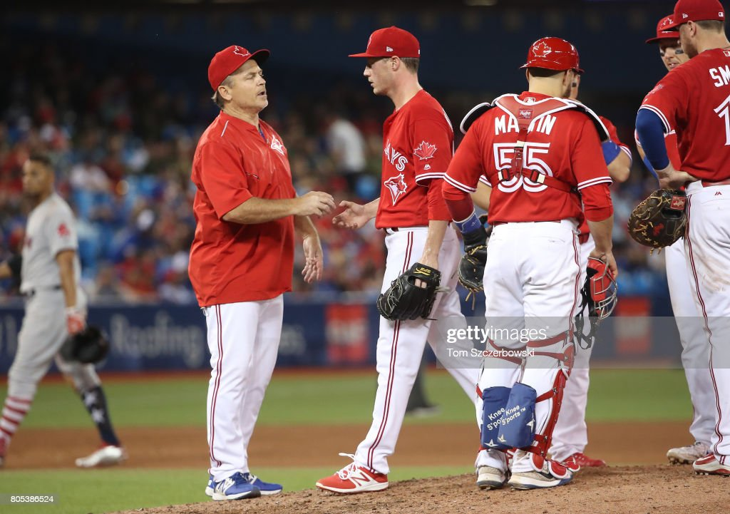 Lucas Harrell #47 of the Toronto Blue Jays exits the game as he is relieved by manager John Gibbons #5 in the ninth inning during MLB game action against the Boston Red Sox at Rogers Centre on July 1, 2017 in Toronto, Canada.
