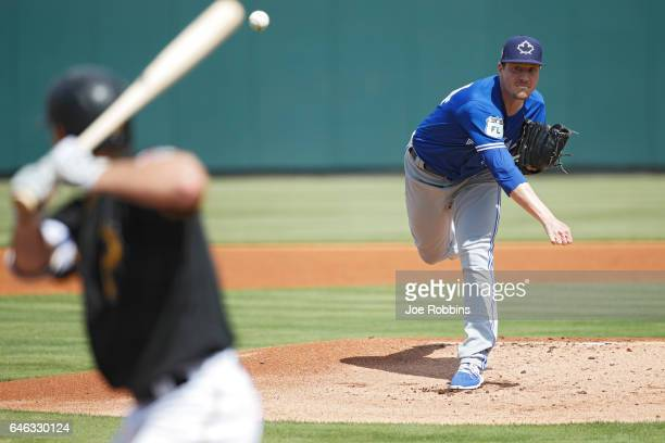 Lucas Harrell of the Toronto Blue Jays pitches in the first inning of a Grapefruit League spring training game against the Pittsburgh Pirates at...