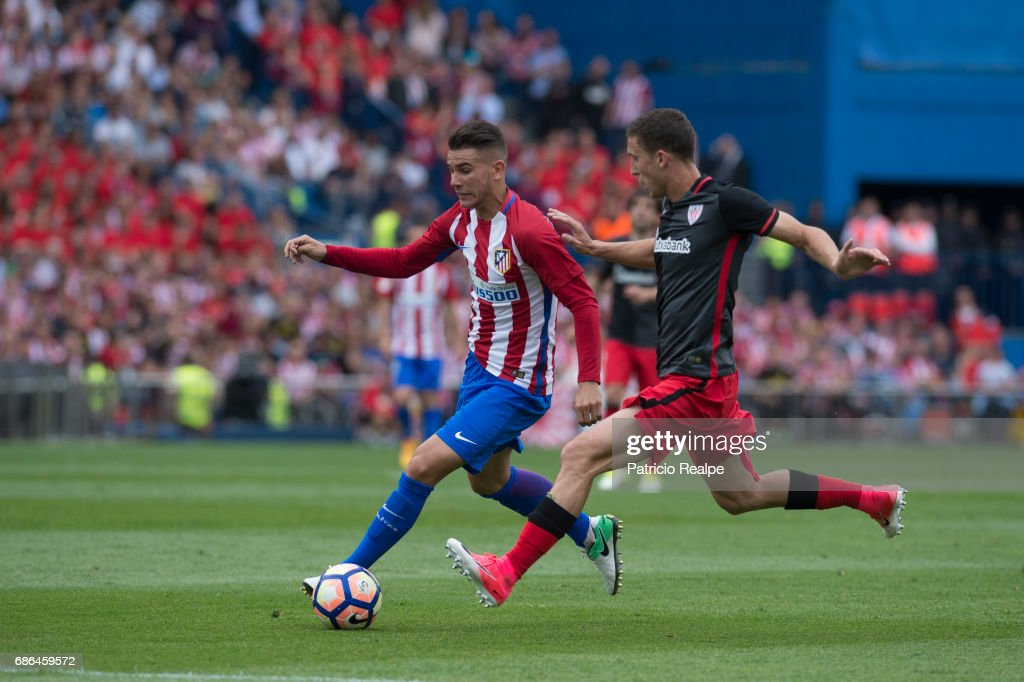 Lucas Herandez of Atletico de Madrid competes for the the ball with Oscar de Marcos of Athletic Club Bilbao of the La Liga match between Club Atletico de Madrid and Athletic Club Bilbao at Vicente Calderon stadium on May 21, 2017 in Madrid, Spain.