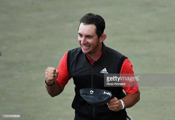 Lucas Herbert of Australia celebrates after winning on the second playoff hole during Day Four of the Omega Dubai Desert Classic at Emirates Golf...