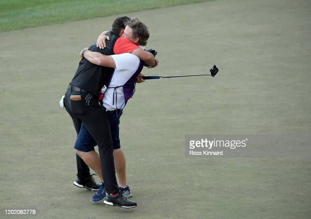Lucas Herbert of Australia celebrates his birdie putt in the second play-off hole during the final round of the Omega Dubai Desert Classic at...