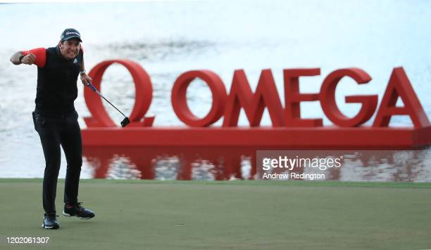 Lucas Herbert of Australia celebrates his victory at the second play-off hole of the Omega Dubai Desert Classic at Emirates Golf Club on January 26,...