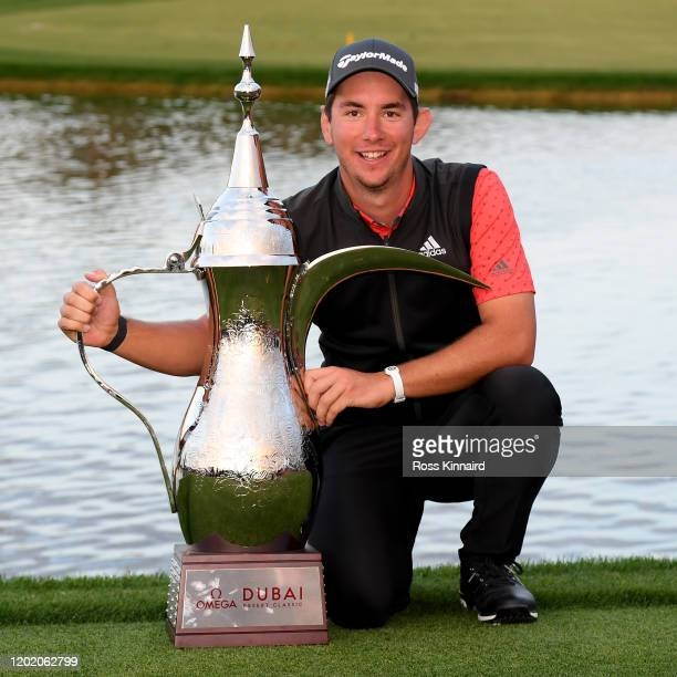 Lucas Herbert of Australia celebrates with the winners trophy after the final round of the Omega Dubai Desert Classic at Emirates Golf Club on...