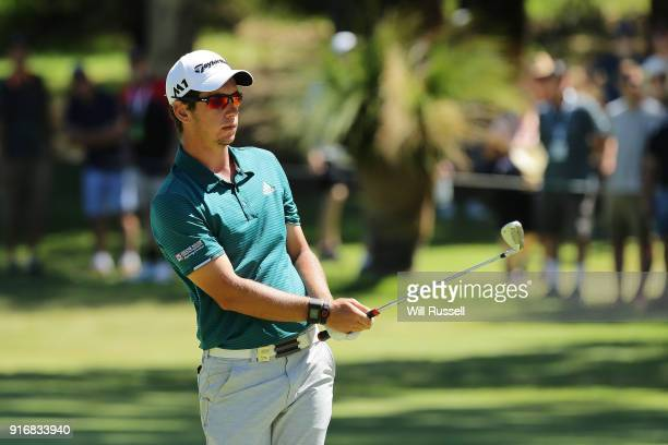 Lucas Herbert of Australia chips onto the green in the semi final match against Kiradech Aphibarnrat of Thailand during day four of the World Super 6...