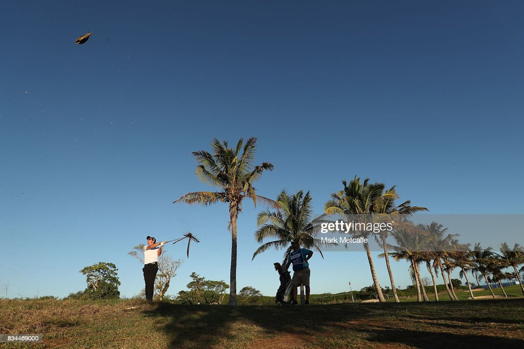 Lucas Herbert of Australia hits his approach shot on the 18th hole during day two of the 2017 Fiji International at Natadola Bay Championship Golf Course on August 18, 2017 in Suva, Fiji.