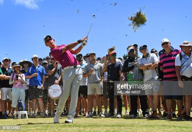 TOPSHOT Lucas Herbert of Australia hits to the green during the final round of the Australian Open played at the Australian Golf Club course in...