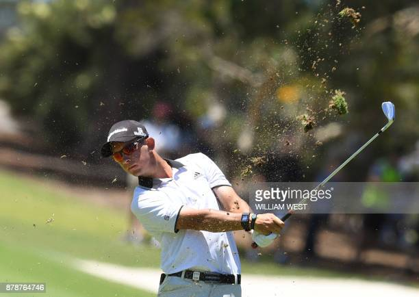 Lucas Herbert of Australia hits to the green during the third round of the Australian Open played at the Australian Golf Club course in Sydney on...