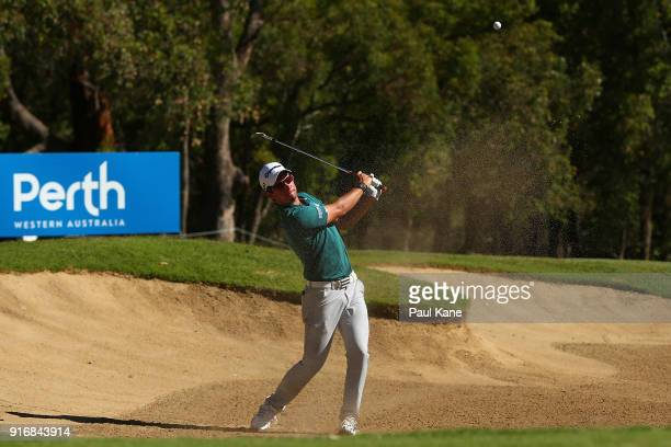 Lucas Herbert of Australia plays out from a green side bunker in the semi final match against Kiradech Aphibarnrat of Thailand during day four of the...