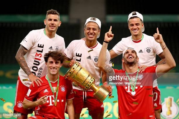 Lucas Hernandez Alvaro Odriozola Thiago Alcantara Javier Martinez and Philippe Coutinho of FC Bayern Muenchen pose with the trophy in celebration...