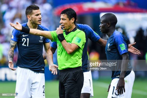 Lucas Hernandez and Ngolo Kante of France talks with referee Alireza Faghani during the FIFA World Cup Round of 16 match between France and Argentina...